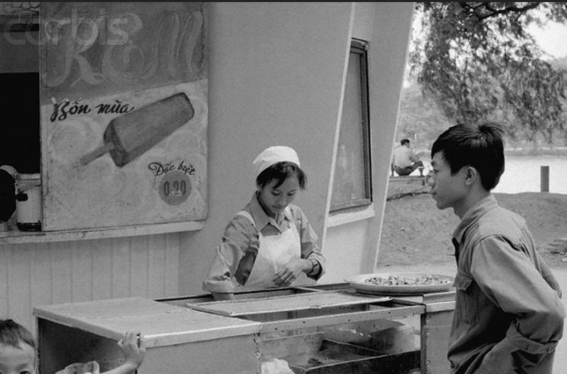 24 Nov 1973, Hanoi, North Vietnam --- Hanoi Hanoi Eskimo Pies. A woman vendor sells ice cream from a stand at the Lake of the Restored Sword in Hanoi. American antiwar activist Cora Weis