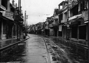 62 Street standing deserted shortly before Communist takeover of city from the French. Oct 10, 1954