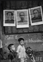 65g children playing under posters displaying Communist leaders. Hanoi Oct 1954