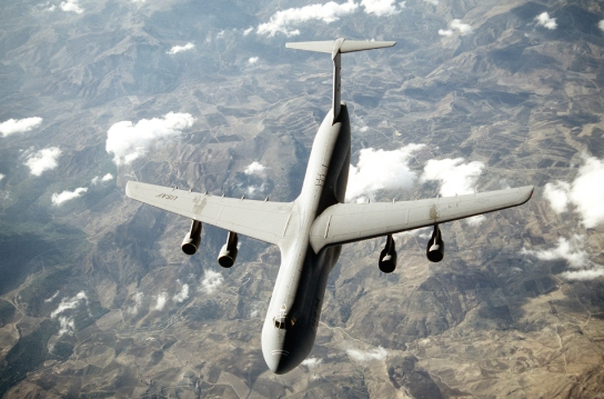 "With its tremendous payload capability, the gigantic C-5 Galaxy, an outsized-cargo transport, provides the Air Mobility Command intertheater airlift in support of United States national defense. The C-5 is one of the largest aircraft in the world. It can carry outsized cargo intercontinental ranges and can take off or land in relatively short distances. Ground crews can load and off load the C-5 simultaneously at the front and rear cargo openings since the nose and aft doors open the full width and height of the cargo compartment. It can also ""kneel down"" to facilitate loading directly from truck bed levels. (U.S. Air Force photo by Brett Snow)"